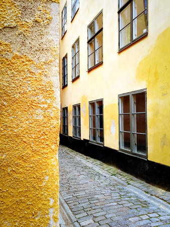 gamla stan: Bright yellow buildings in Gamla Stan, the old center of Stockholm. Stock Photo