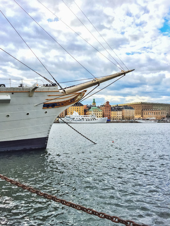 gamla stan: White ship and view over historic Gamla Stan in Stockholm, Sweden. Stock Photo