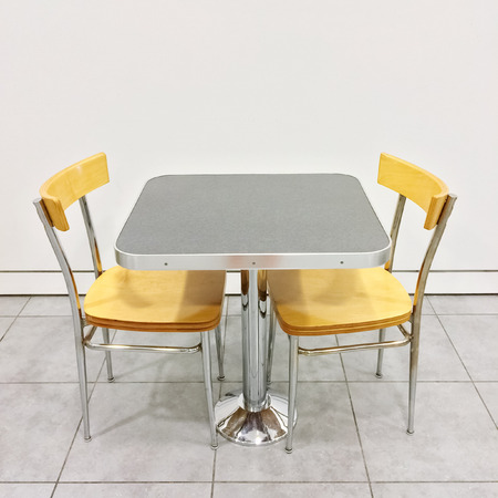 two chairs: Simple table with two chairs in a cafeteria. Stock Photo