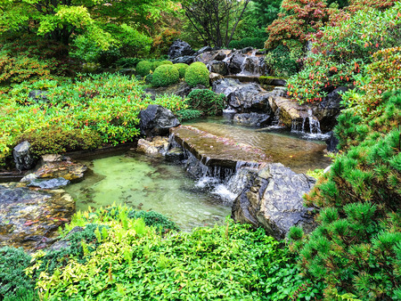 Japanese garden with water cascades in early autumn. photo