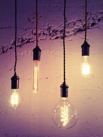 industrial: Illuminated light bulbs on purple background. Industrial design.