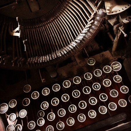 Close-up of a dark and rusty vintage typewriter. photo