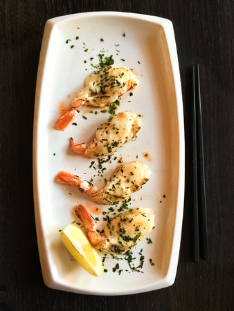 shrimp: White plate with grilled shrimps. Japanese tapas, traditional cuisine.
