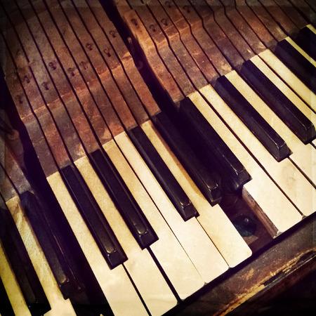 piano closeup: Keys of a broken antique piano, retro style photo.