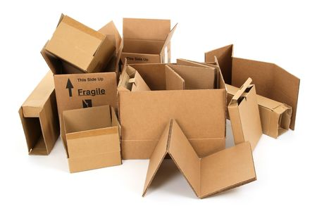 shipped: Pile of used cardboard boxes on white background. Stock Photo