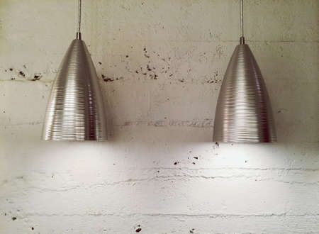 lamp shade: Two metal lamps near white wall  Contemporary design   Stock Photo