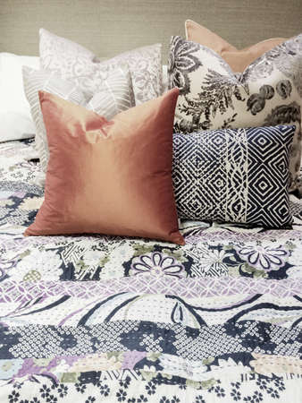 bedclothes: Close-up of a bed with lots of colorful pillows  Stock Photo