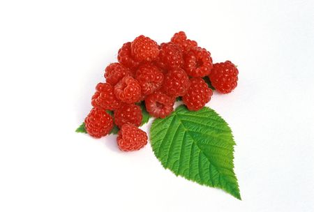 lays: fresh, appetizing, just the collected forest raspberry lays on a green leaf...