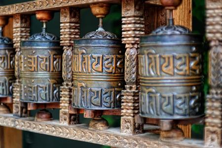 lamaism: Buddhist Prayer Rolls with the put texts of a pray Stock Photo