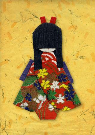 Origami geisha sur du papier � la main jaune Banque d'images