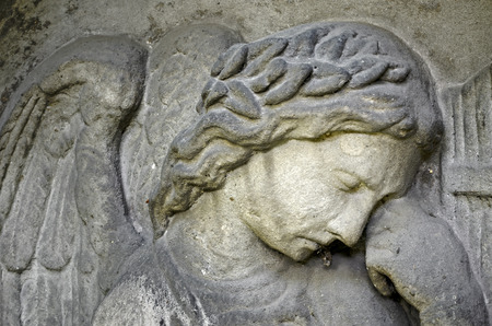 Weathered relief of an Angel - tombstone - old Prague cemetery, Czech republic, Europe Stock Photo
