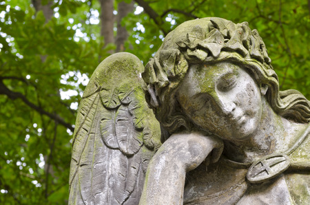 catholic angel: Weathered statue of an Angel - tombstone - old Prague cemetery, Czech republic, Europe Stock Photo