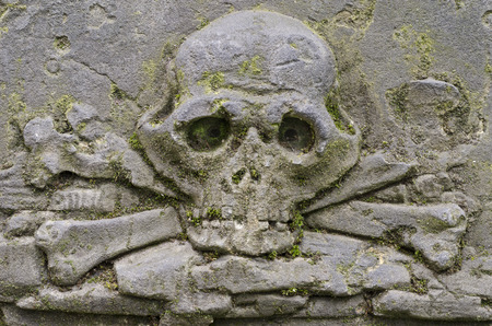 Carved skull with crossbones on the Tombstone - old Prague cemetery, Czech republic, Europe Stock Photo