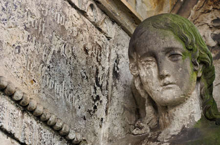 Angel without face - eroded statue at old cemetery, Krasna Lipa, Czech republic, Europe
