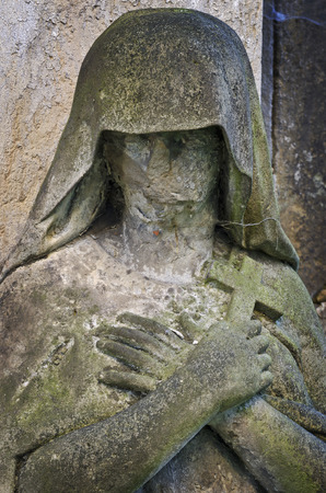 Mourning statue without face - old cemetery, Krasna Lipa, Czech republic, Europe Stock Photo