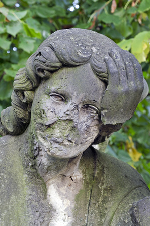 Angel without hand - statue at old cemetery - circa 1860, Krasna Lipa, Czech republic, Europe