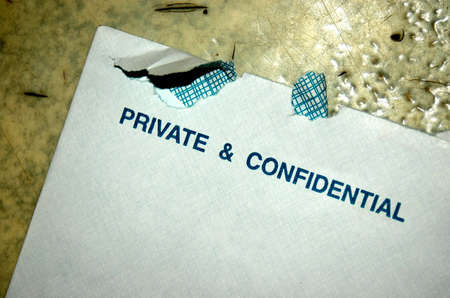 envelop: An opened white envelop which is private and confidential Stock Photo