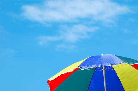 A colorful summer sunshade in front of blue sky with some clouds Stock Photo - 707939