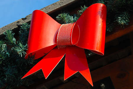 A red ribbon as a decoration on a shopping center outside photo