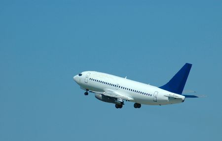 A big blue and white airplane taking off in the air photo