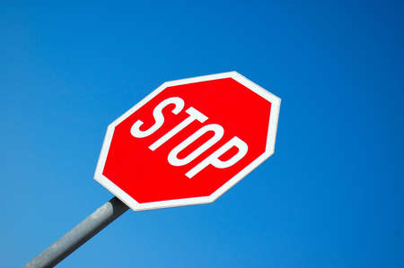 diagonale: A traffic warning sign for STOP with blue sky background Stock Photo