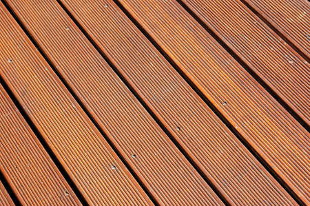 diagonale: A brown background of a clean and tidy wooden floor on a terrace outdoors for decoration