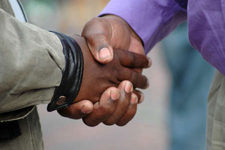 warm welcome: Two African American men shaking their black hands as a sign of big friendship and to say goodbye  Stock Photo