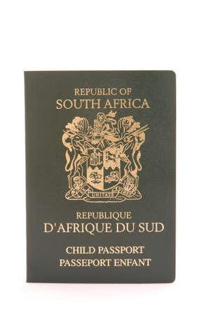 national identity: Un verde scuro e oro bambino passaporto da Sud Africa isolato su sfondo bianco