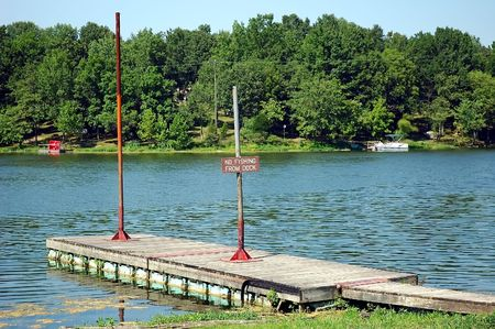 No Fishing sign on the dock in this small lake in Kentucky, USA. photo