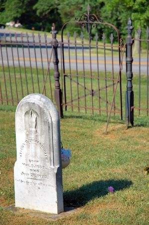fenced in: Gravestone - Old Cemetery Grave Marker - tombstone fenced in and gated. Stock Photo