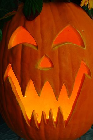 Jack O Lantern - Lighted carved pumpkin face. photo