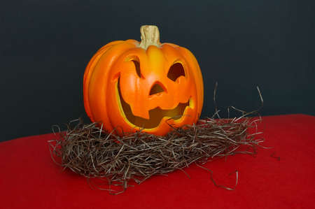Jack O Lantern - A small carved Halloween pumpkin with winking eyes and a crooked smile. Stock Photo