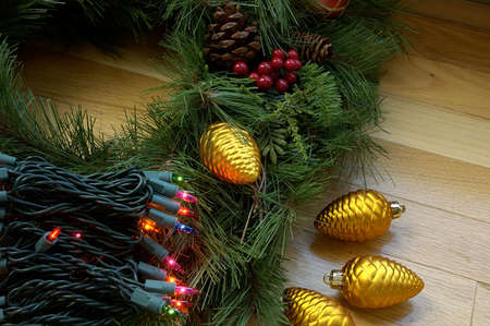 Christmas Decor - Christmas tree lights, ornaments and pine branches ready to decorate for the holidays. photo