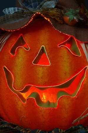 Jack O Lantern - Fiber Optics lighted carved Halloween pumpkin with a jagged happy smile.