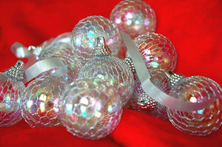 irridescent: Christmas Ornaments - irridescent balls and silver ribbon on red fur fabric.