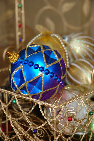 Christmas Ornaments in a Gold Wire Basket
