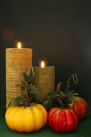 Thanksgiving Table Decor - Lighted candles and decorative gourds.