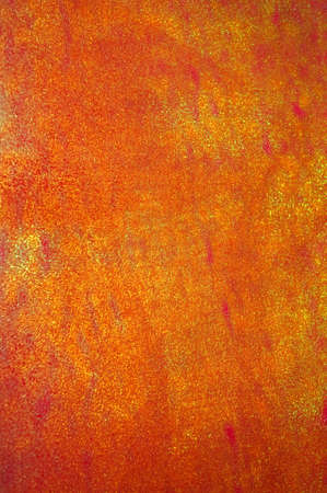 Orange and gold shiny textured paper background.