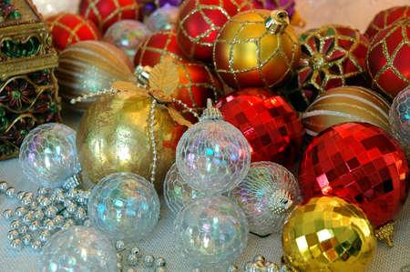 dozens: Christmas Tree Ornaments - Dozens of red, white and gold Christmas tree ornaments ready for holiday decorating.