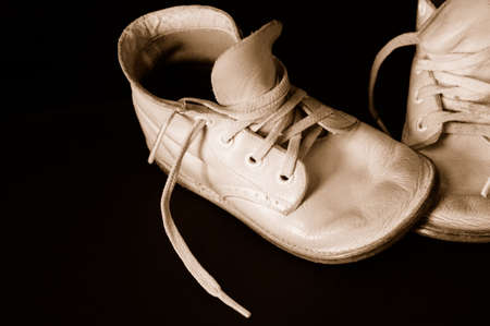 constitutionality: Vintage  shoes over black.