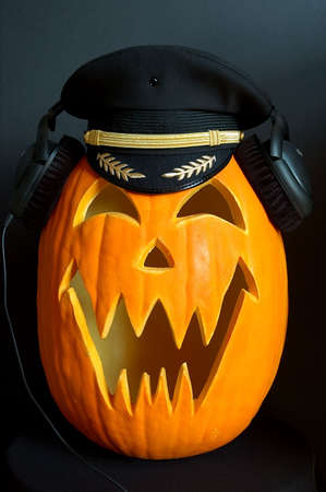 Halloween carved pumpkin with headset and pilot cap photo