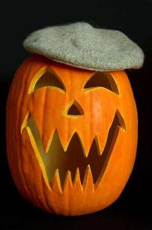 jackolantern: Halloween Carved Pumpkin with Knit Tam Stock Photo