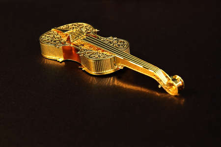 sparkly: Gold violin on a sparkly bronze background paper.
