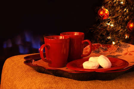 Hot Drinks and Powdered Sugar Donuts by the Fire Stock Photo