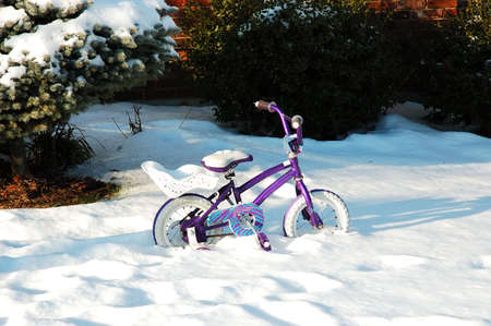 going nowhere: This kids going nowhere.  A toddlers tiny bicycle is stuck in the snow drift.
