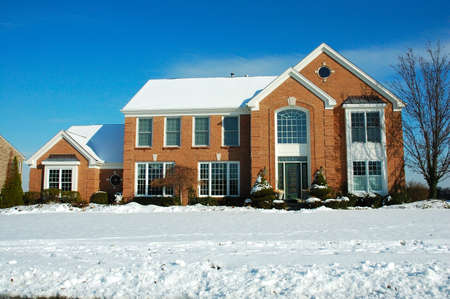 Two story brick American house in the suburbs in winter. Stock Photo