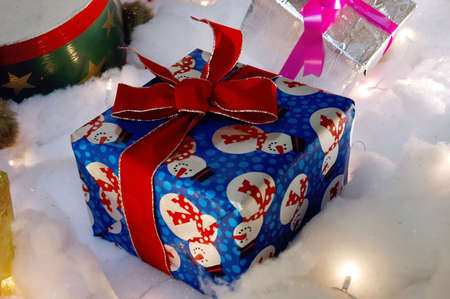 Wrapped gifts with bows, sitting in fake snow. Stock Photo - 291525