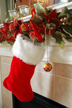Christmas stocking hanging on the fireplace mantle. Stock Photo