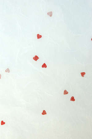 inclusions: Handmade fabric paper with red valentine heart inclusions.