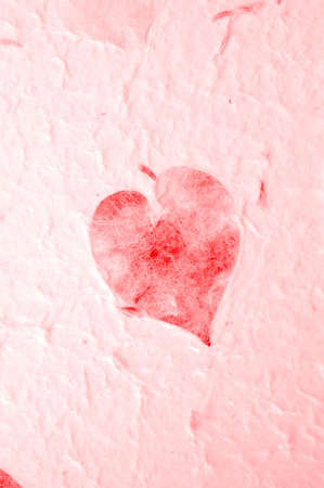 inclusions: Handmade paper with red heart shaped leaf inclusions. Stock Photo